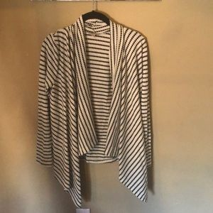 A white cardigan with black stripes
